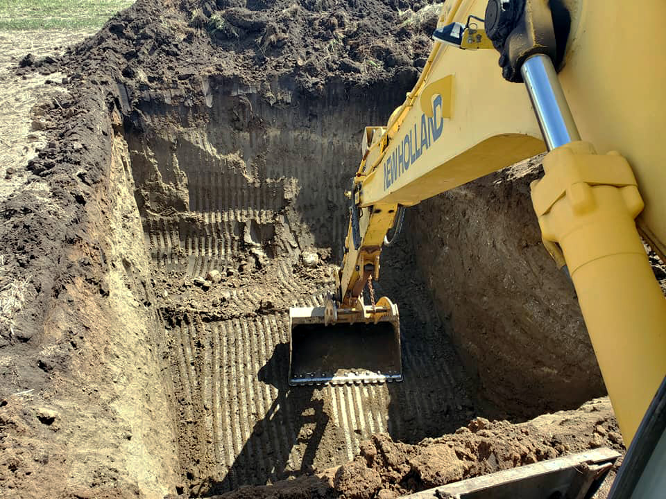 Excavation machine digging a hole.